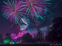 Purple, pink and green fireworks in sky