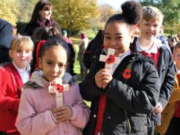 Schoolchildren with poppy cross