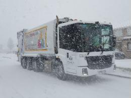 Refuse truck in snow