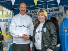 Ipswich MP Sandy Martin shaking hand with Helen Sismore from Guide Dogs UK