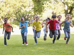 Happy kids running in park