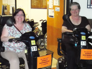 Shopmobility volunteers on scooters